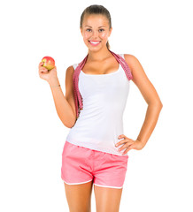 Fitness woman with a measuring tape isolated on a white