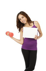 Young fitness woman with an advertisement board