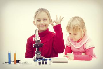 children and microscope