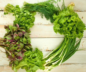 various herbs on wooden table closeup