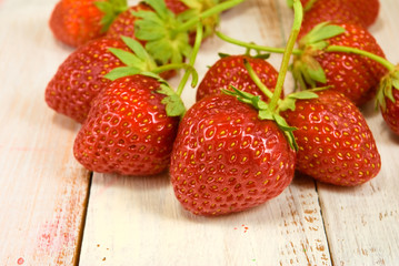 ripe and sweet strawberries on wooden table closeup