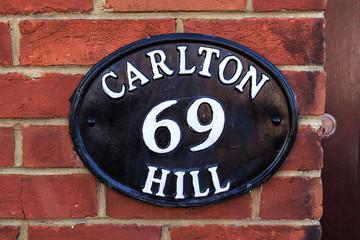 Metallic old number plate, Brighton, United Kingdom