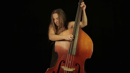 Woman with bass on a black background