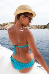 Attractive girl  on a yacht in summer