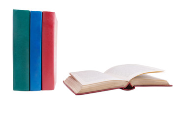 green, blue and red book on white background