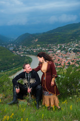 Man and woman in Georgian national dress.