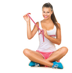 Sporty girl checking breast measurement with a measuring tape