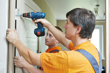 door installation workers