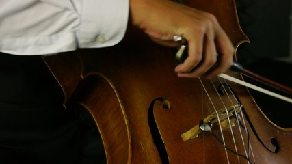 Tight shot from below of cello strings being played