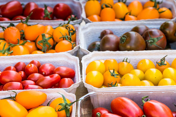 small tomatoes on display at the farmers market