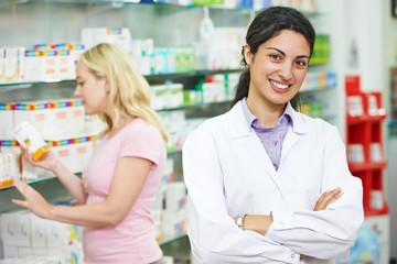 Pharmacy chemist portrait in drugstore