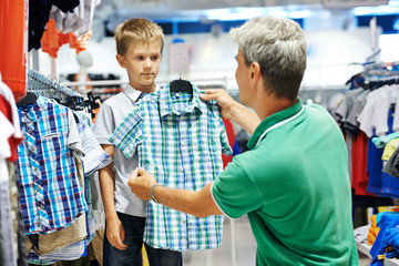 man and boy shopping clothes