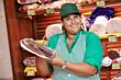 Shopping. Female worker in supermarket