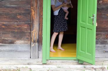 Woman with baby on open door