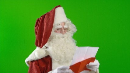 Santa Claus is Reading a Wish List and is Satisfied