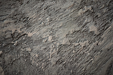 Close-up view of cracked solid natural stone background