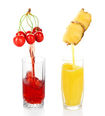 Juice pouring from fruits into glass, isolated on white