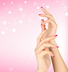 Young woman hands with elegance manicure on bright background