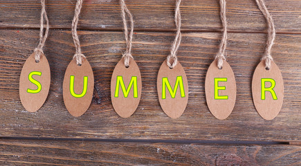 Summer tags on wooden background