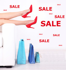 Concept of discount. Female legs in red shoes