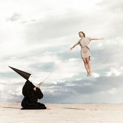 Woman flying like a kite driven by mysterious person