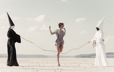 Woman hoping over the rope held by two mysterious persons