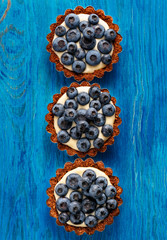 Tarts with fresh blueberries and delicate cream