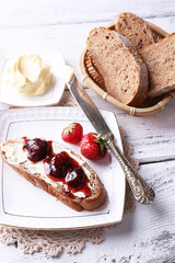 Fresh toast with homemade butter and strawberry jam