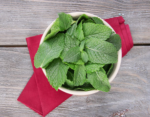 Brown round bowl of fresh mint leaves
