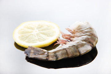 Fresh tasty prawn with lemon and dill on white background