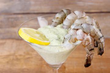 Martini glass of fresh tasty prawns with lemon and sauce