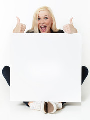 Woman with message board shows thumbs up