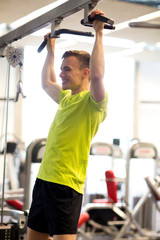 smiling man exercising in gym