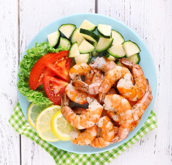 Plate of fresh boiled prawns with tomatoes, lettuce, lemon and
