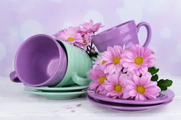 Bright cups and saucers with flowers
