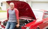 Retired Senior Man Working On Restored Classic Car
