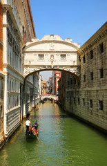 Venice. Gondolas passing over Bridge of Sighs