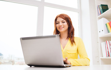 businesswoman with laptop computer in office