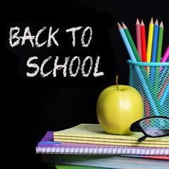 Back to School. School Supplies over black