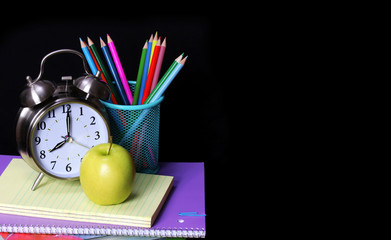 School Supplies over black background. Studies Accessories