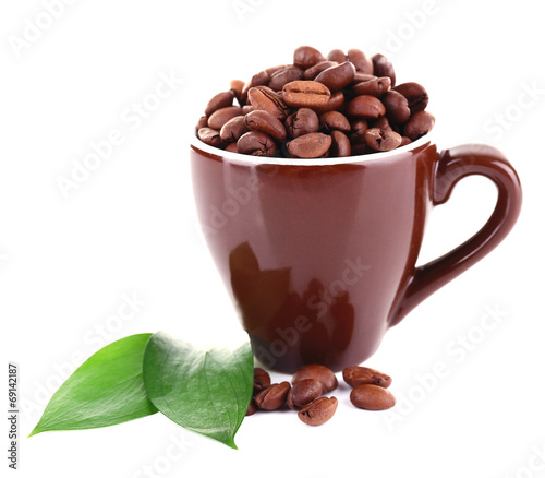 canvas print picture Mug of coffee beans isolated on white