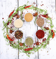Spices in glass round bowls with herbs and chilly pepper