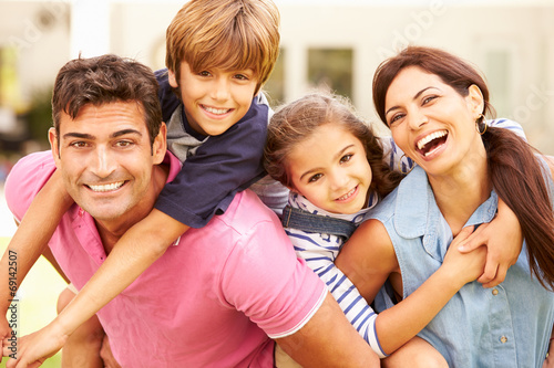 canvas print picture Portrait Of Happy Family In Garden At Home