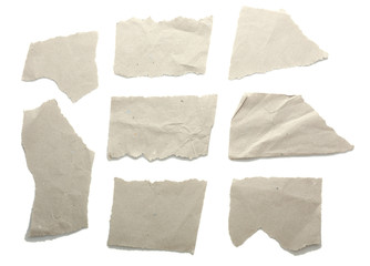 Torn blank papers isolated on white