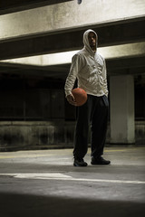 Portrait of a hooded basketball player standing facing camera