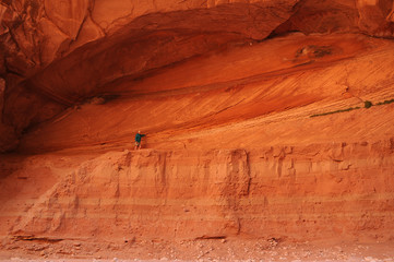 Elder Female Hikes Alcove at end of Wire Pass Canyon, Utah