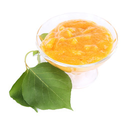 tasty apricot jam with leaves, isolated on white