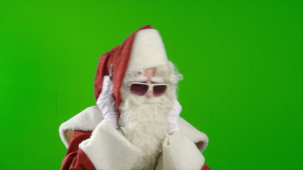 Santa Claus with Headphones and Sunglasses, Listening to Music