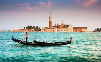 Gondola with San Giorgio Maggiore at sunset, Venice, Italy