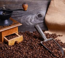 Coffee grinder sack and vintage scoop with coffee beans